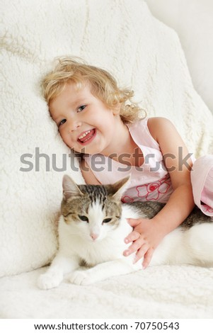 Little happy girl with a cat