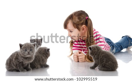 Little happy girl with a cats. isolated on white background - stock photo