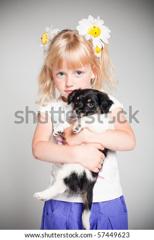 little happy girl with puppy