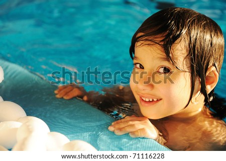 Little happy kid in the pool