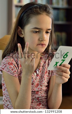 Little Hispanic Girl doing Math Cards