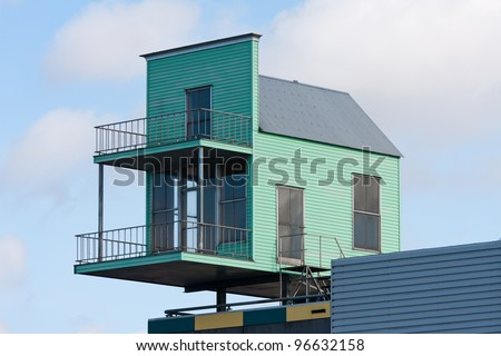 Little house at the top of a bigger building
