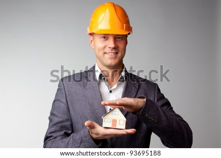 Little House on the hands of a man