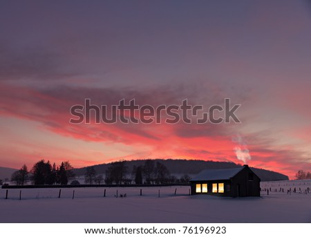 Little House With Decorated Windows Lighted In Front Of A Winter ...
