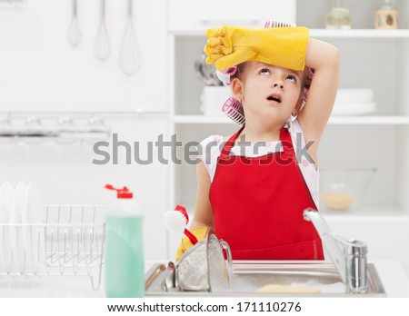 Little housekeeping fairy girl tired of home chores - doing the dishes