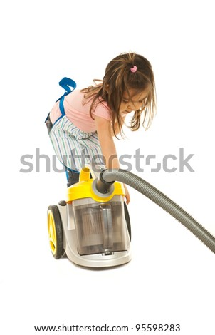 Little housewife girl  click button on vacuum cleaner isolated on white background