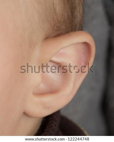 Little human child one listening silence ear macro