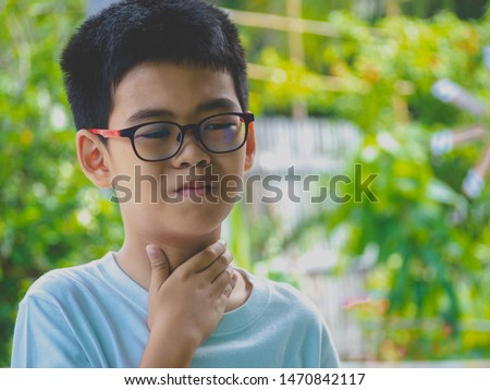Little ill boy get sore throat or choking can't breath with unhappy. Allergy concept