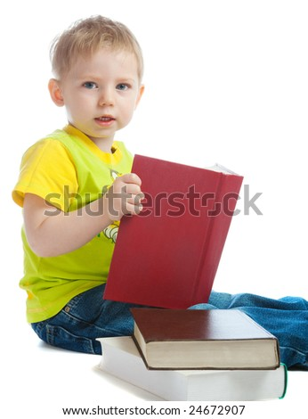 Little intelligent boy with a thick book in hands