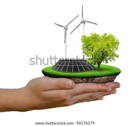 Little island with solar panel and wind turbines in the hands isolated on white