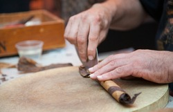 Little Italy, Manhattan, New York. Italian man rolling cigars on street festival.