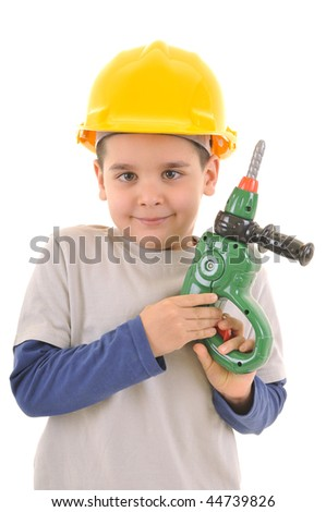 Little kid as a construction worker wearing yellow helmet with a toy drill in his hand..White background studio picture.