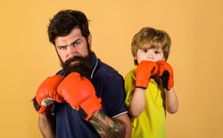 Little kid boxing with dad. Sport lifestyle. Training together. Boxing. Man boxer. Ready for sparring. Family workout. Parenthood. Family relationships.