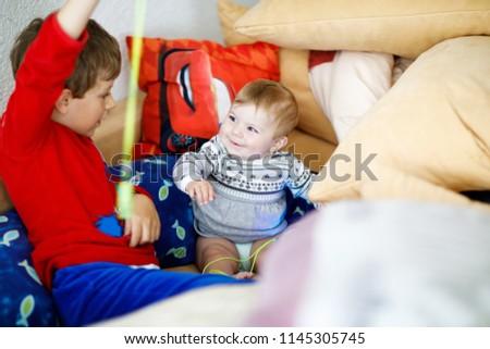 Two lads boning around on a sofa
