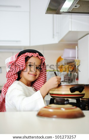 Little kid boy is cooking