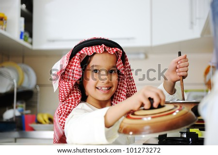 Little kid boy is cooking - stock photo