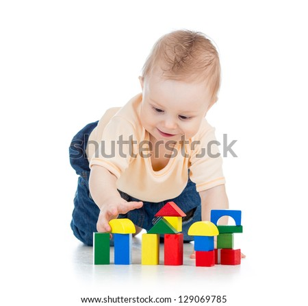 little kid boy playing with building blocks