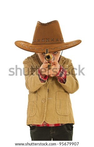 Little kid cowboy playing with weapon isolated on white background - stock photo