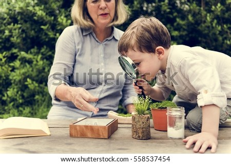 Little Kid Experimenting Science Magnifying Glass