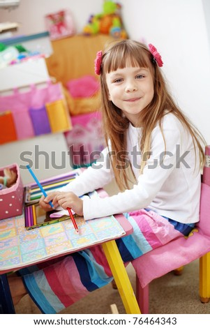 Little kid girl painting at home