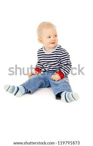 little kid plays with toys isolated on white background
