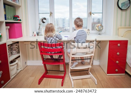 little kids are doing homework