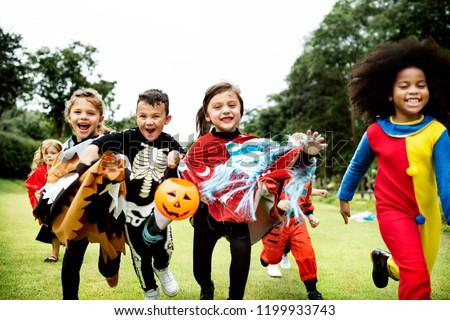 Little kids at a Halloween party - Shutterstock ID 1199933743