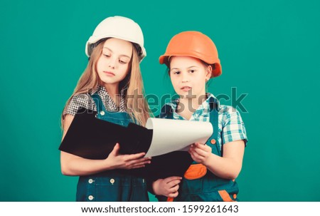 Little kids in helmet with tablet. school project. Happy children. Foreman inspector. Labor day. 1 may. small girls repairing together in workshop. Foreman kids. Foreman in helmet. Foreman children.