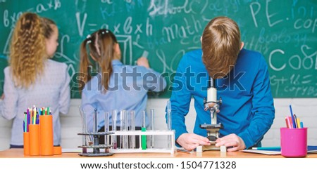 Little kids learning chemistry in lab. Chemistry equipment. Happy children. Chemistry lesson. Chemistry education. students doing biology experiments with microscope in lab. Scientific experiment.