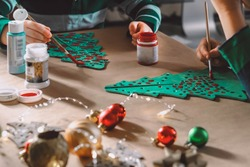 little kids making christmas decorations
