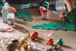 little kids making christmas decorations