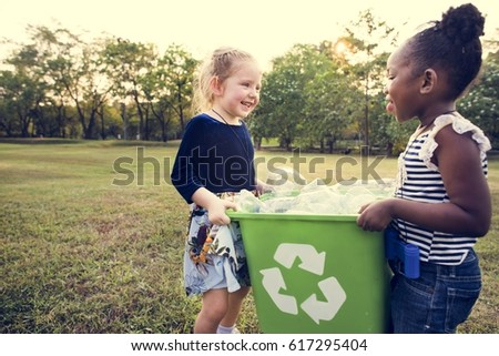 Little Kids Separating Recycle Can to Trash Bin