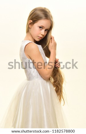 little lady. little lady in white dress. little lady with long blonde hair. little lady isolated on white