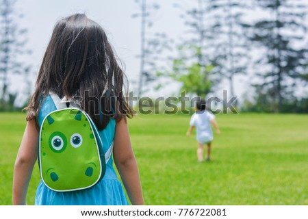 Little latin girl with backpack in the park. #776722081