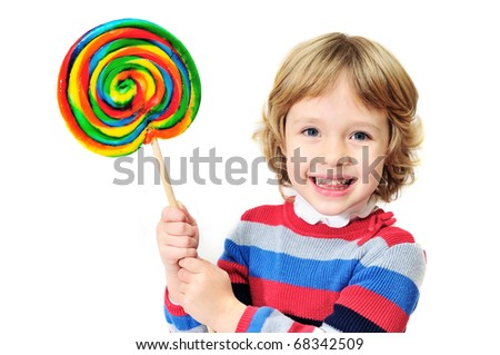 little laughing  girl holding big colorful lollipop
