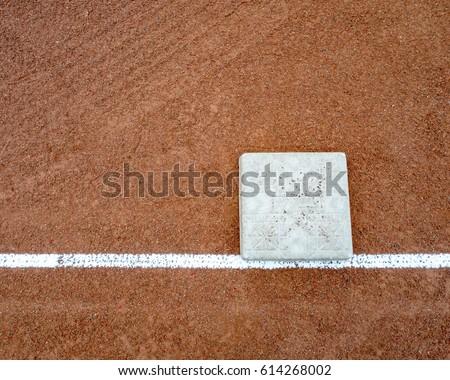 Little league bases on high school baseball diamond.