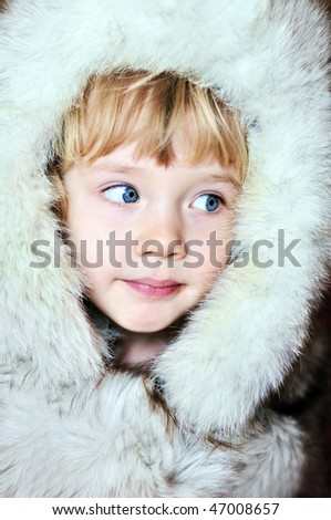 little lovely  girl wearing fur hat