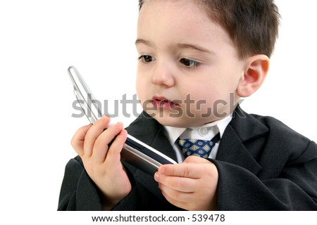 Little man discussing important business on the cell phone. Focus on eye nearest camera and hands.  Shot in studio over white.