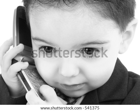 Little man discussing important business on the cell phone in black and white.