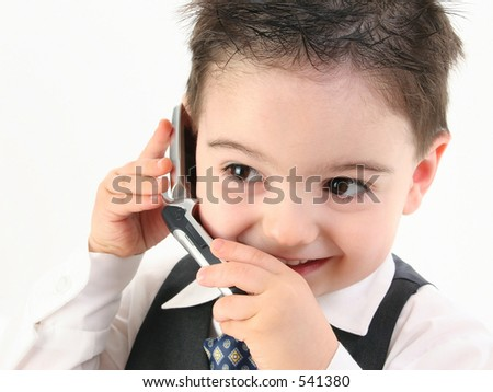 Little man discussing important business on the cell phone. Shot in studio over white.