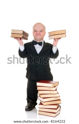 Little man, dwarf teacher in a formal suit holding two stack of books, encyclopedia, studio shot, white background