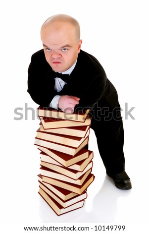 Little man, dwarf teacher in a formal suit leaning on stack of books, encyclopedia, studio shot, white background