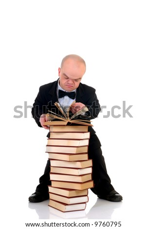Little man, dwarf teacher in a formal suit reading in stack of books, encyclopedia, studio shot, white background