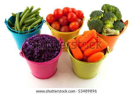 Little metal buckets with fresh vegetables on white background