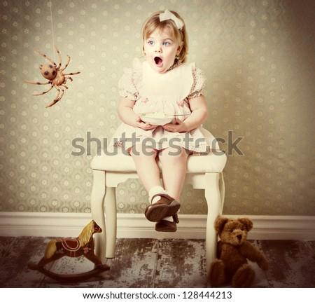 Little Miss Muffet shocked by spider