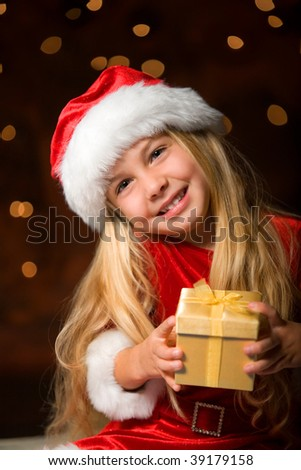 little miss santa with a gift