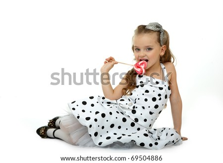 Little Miss with a candy, isolated on white background