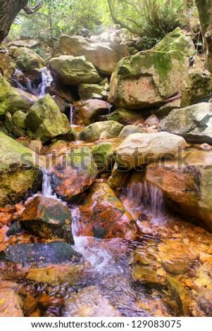 Little mountain river waterfall. Shot in Hottentots Holland Mountains, Vergelegen area, near Somerset West, Western Cape, South Africa.