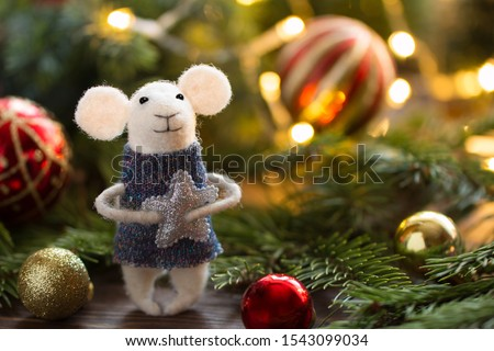 Little mouse toy, symbol of Chinese happy new 2020 in blue dress and new year decoration.  Horoscope sign 2020. New Year 's 2020 Symbol. Greeting Christmas card. Front view. Selective focus.