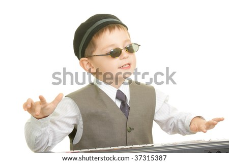 Little musician playing on piano against white background